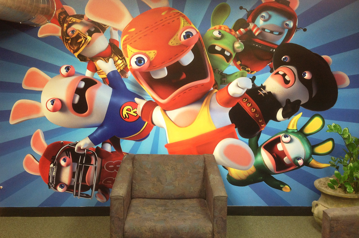 Wall mural of video game promotional art inside of a waiting room.