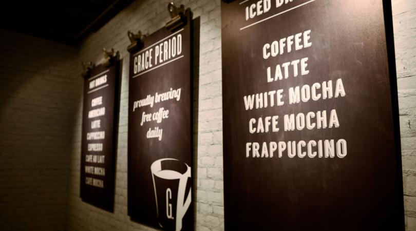 Printed menu board mounted on a wall